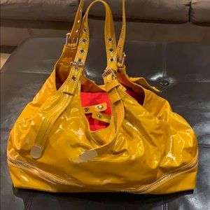 Fantastic mustard color pocketbook.